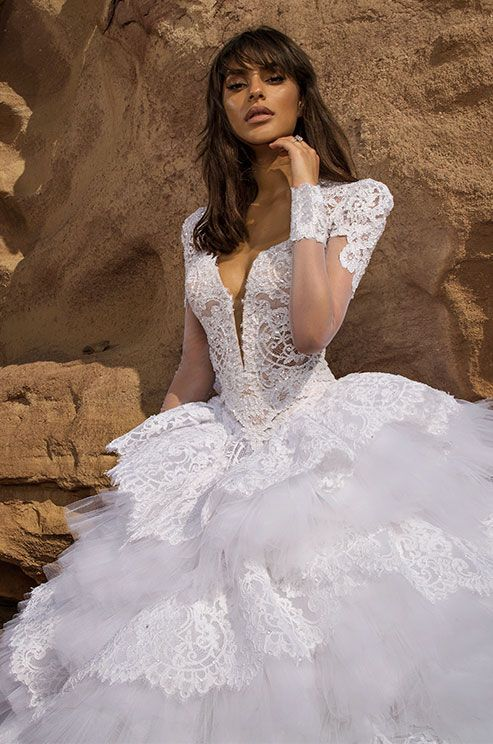 Pnina Tornai 2016 bridal collection is an ode to water, the way it flows and interwines with wind and sand to create new spirit and energy. Inspired by how wind moves water, creating breathtaking reflections of light, and how waves break and fluff as they hit the sand, The designer have combind wate