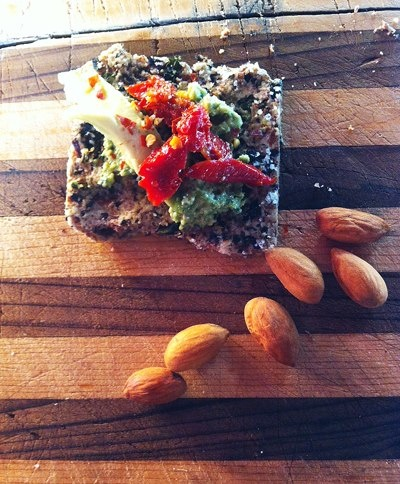 almond meal/kale/sesame/garlic cracker with garlic chive walnut pesto ...