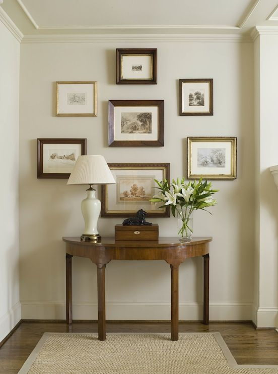 Phoebe Howard: Elegant, traditional foyer in monochromatic color scheme. Framed collection of prints, ...