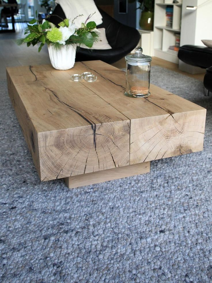 Wooden beam coffee table. Add floor cushions. Equals casual elegant space.