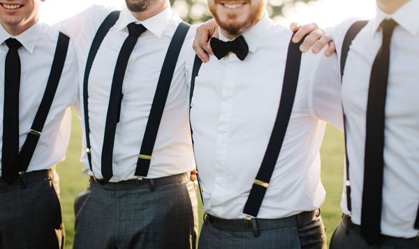 groom and groomsmen in black grey and white braces bowtie tie white shirt wedding attire