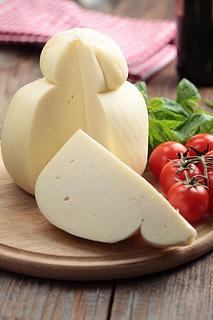 Caciocavallo cheese with tomato and basil