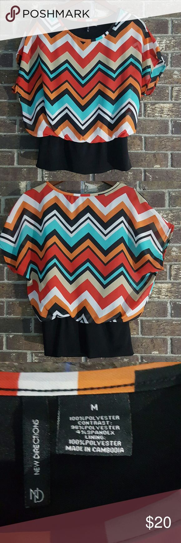 🌻 New Directions Chevron Blouse This multi color chevron blouse is in excellent condition. It has an attached torso lining and fitted stretchy band at waist. Very comfy and  extremely versatile can be dressed up or down. new directions Tops Blouses