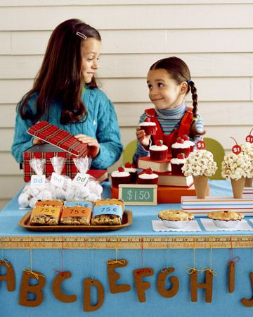 school bake sale {LOVE the yard stick with hanging letters...I think they're cookies! OH, and the popcorn ball ice cream cones too!}