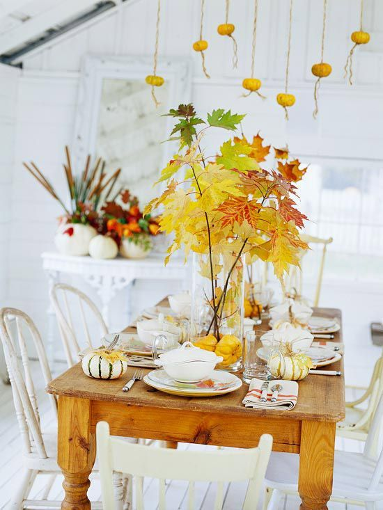 Decorating for fall! Beautiful tablescape using white pumpkins & leaves.