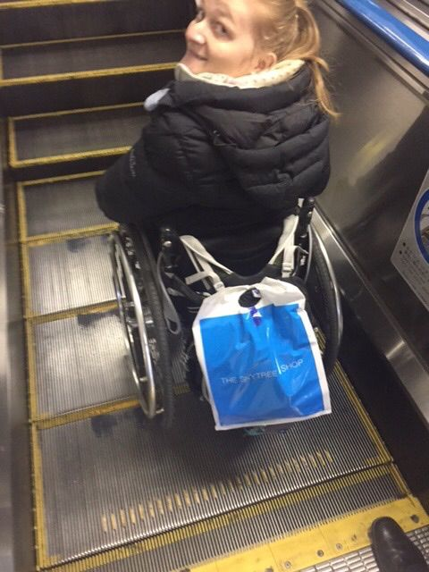 Wheelchair accessible platform on an escalator
