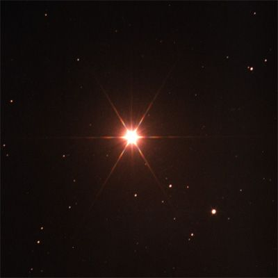 Arcturus, the fourth brightest star in the sky in the constellation Bootes. Its an orange giant star which is cooler than our Sun, but radiates much of its energy in the infrared spectrum. It's also much larger with about 25 times the diameter. To find it in the sky, follow the arc of the handle of the big dipper.