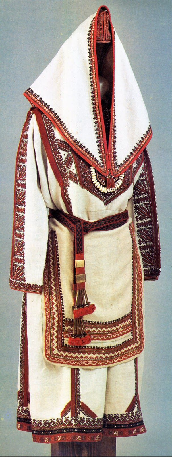 This costume is typical of one group of the Meadow Mari, called the Shymakshan Mari, who occupy the central portion of the Mari El Autonomous Region. This Costume is very rich in embroidery, and is obviously one worn for festive occasions, the headcovering shows that this is for a married woman.