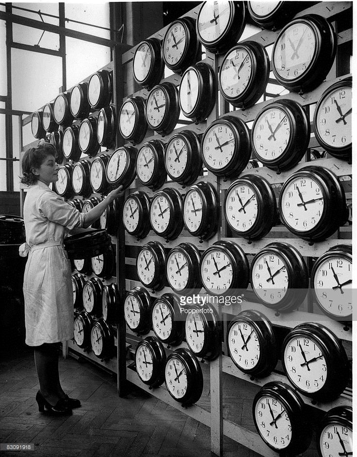 Female worker checking lines of newly produced large clocks at Smith's Clock Factory, Cricklewood, London, February 12 1946