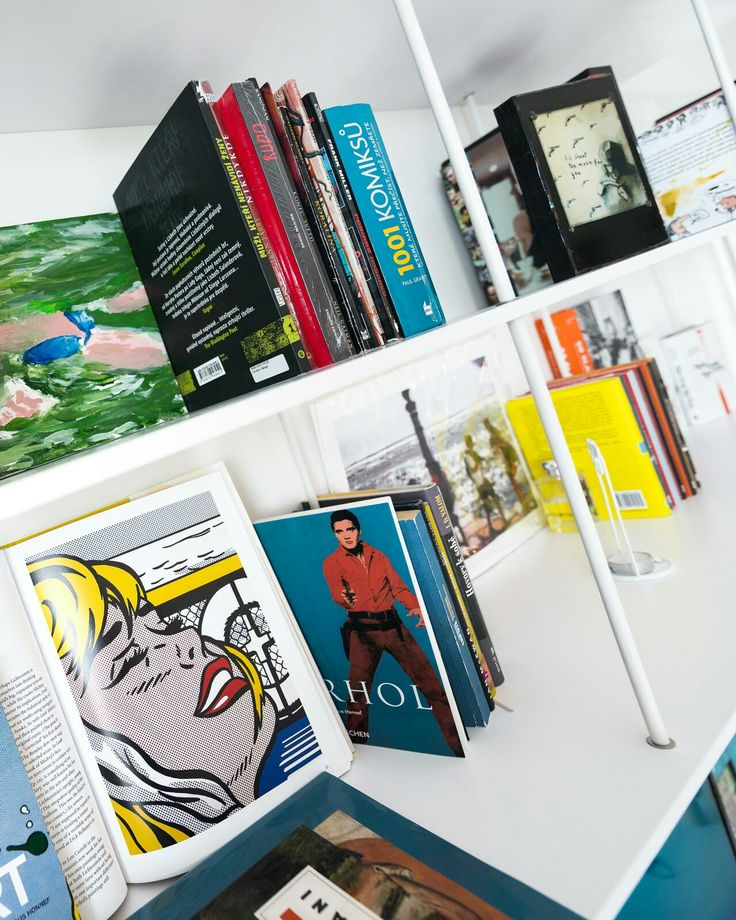 Interior design with Scandinavian elements and a collection of pop art.