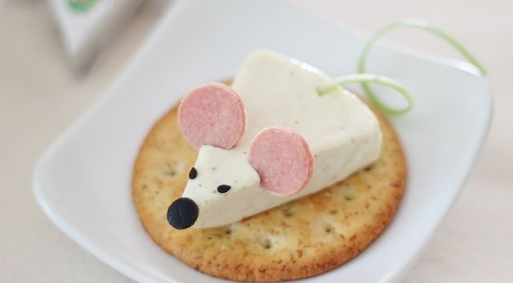 Here is acute appetizeridea for you! Thischeese mouse was made from Happy Cow Cheese Wedge, olive, black sesame seeds, hot...