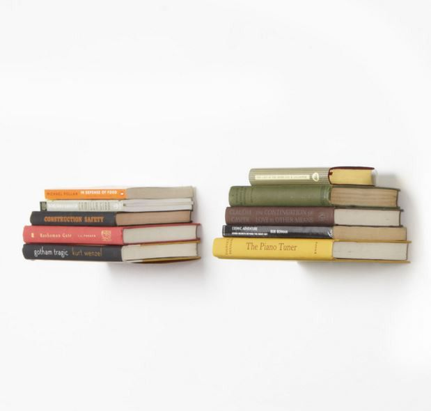 Conceal Invisible Book Shelf by Umbra Transform your books into a work of art. Powder coated steel floating book shelf becomes invisible behind stack of books.