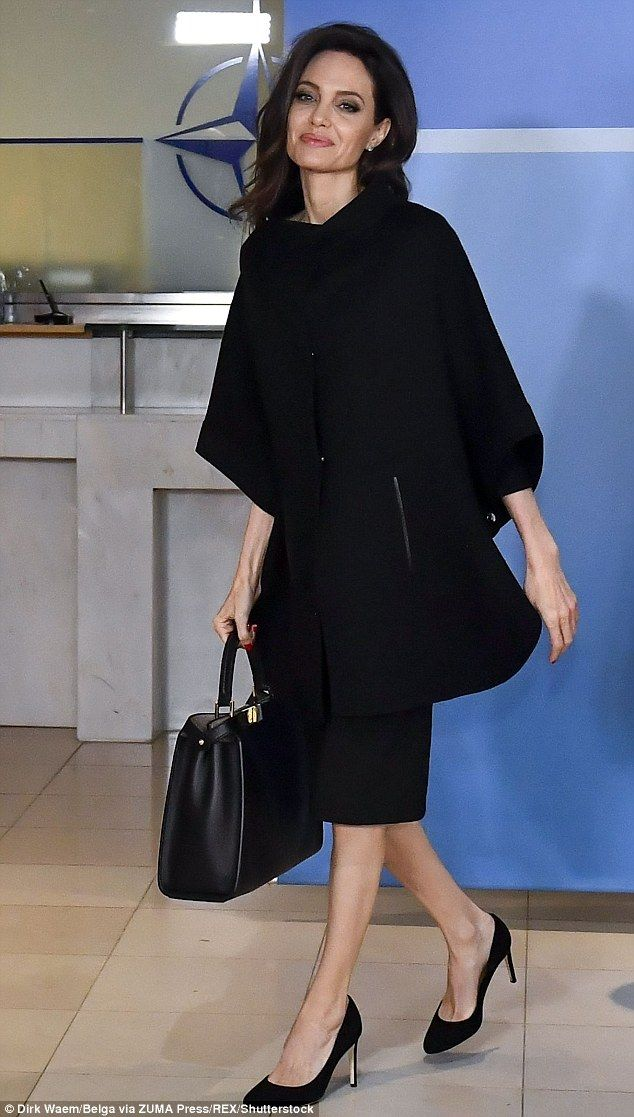 Stylish:The Oscar-winning actress, 42, wore a caped black dress and matching heels for her meeting with NATO secretary general Jens Stoltenberg