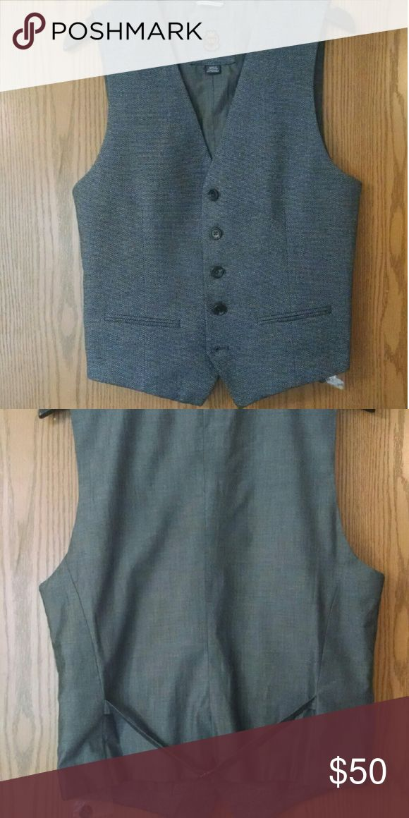 Suit Vest Small - Charcoal This suit vest was worn once. Still has original tags and spare button pouch. Tag is marked Size Small. Fit well on my fiance who normally wheres 40S suit jackets Nordstrom Suits & Blazers Vests