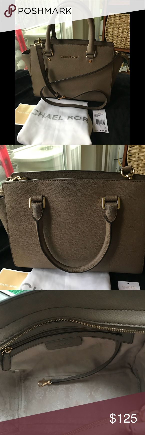 Michael Kors Selma medium satchel Authentic and gently used.  Tags are unattached  Dark Dune color very versatile  Saffiano Leather with gold hard ware  There are small dirt marks inside, back handles have some light darkening, bottom gold ware has some scratches  Comes with a dust bag and MK paper shopping bag! Michael Kors Bags Satchels