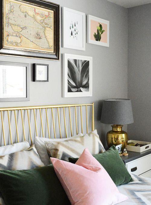 eggshell-home-bedroom-gold-headboard-green-pillows-gallery-wall