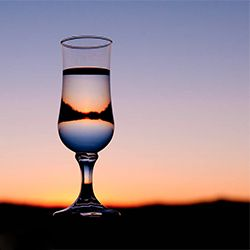 Create some arty shots with a sunset and a glass of water!