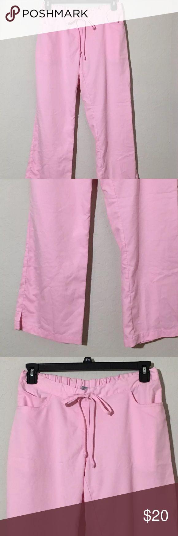 """Grey's Anatomy Pink Scrub Pants Size M Petite Women's Grey's Anatomy pink scrub pants. Size medium Petite. 16"""" waist laying flat, 28.5"""" inseam. Small pen mark on leg. See pics Pants"""