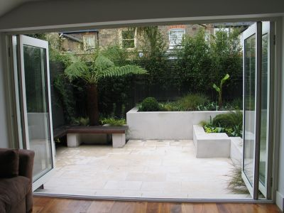 Chic Courtyard  with  folding glass doors from House - Charlotte rowe garden design