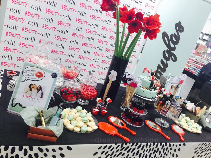 Valentines day store event for Douglas..Welcome table, full of with sweets, cosmetics and red flowers for women...