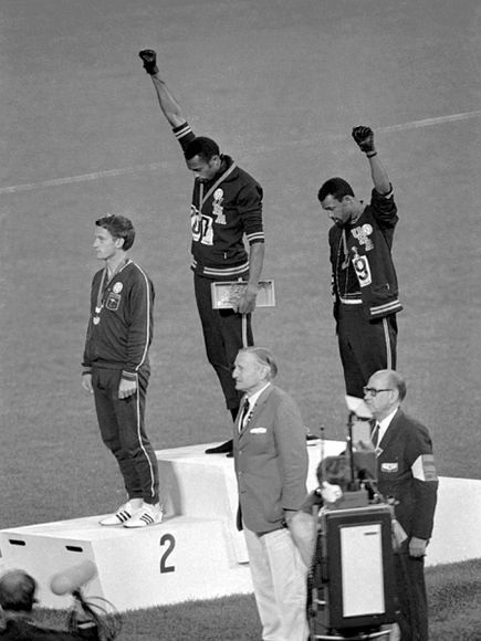 "Moments in Olympics History Photos | Black Power Salute  Photograph by the Associated Press    After placing first and third in the 200-meter run at the 1968 Olympics in Mexico City, American runners Tommie Smith and John Carlos gave the ""Black Power"" salute at the awards ceremony, both wearing a black glove and no shoes to protest the standard of living of minorities in the United States. The International Olympic Committee deemed the action overtly political and ejected the athletes from…"