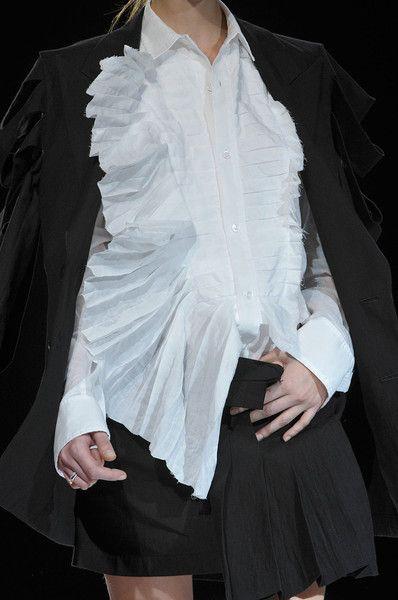 White shirt reinvented with rough asymmetric pleats; fashion details // Yohji Yamamoto