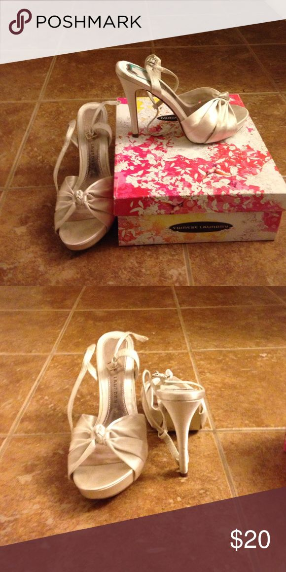 Satin white/cream heels Satin fabric. Heeled sandals with ankle strap. Worn once Chinese Laundry Shoes Heels