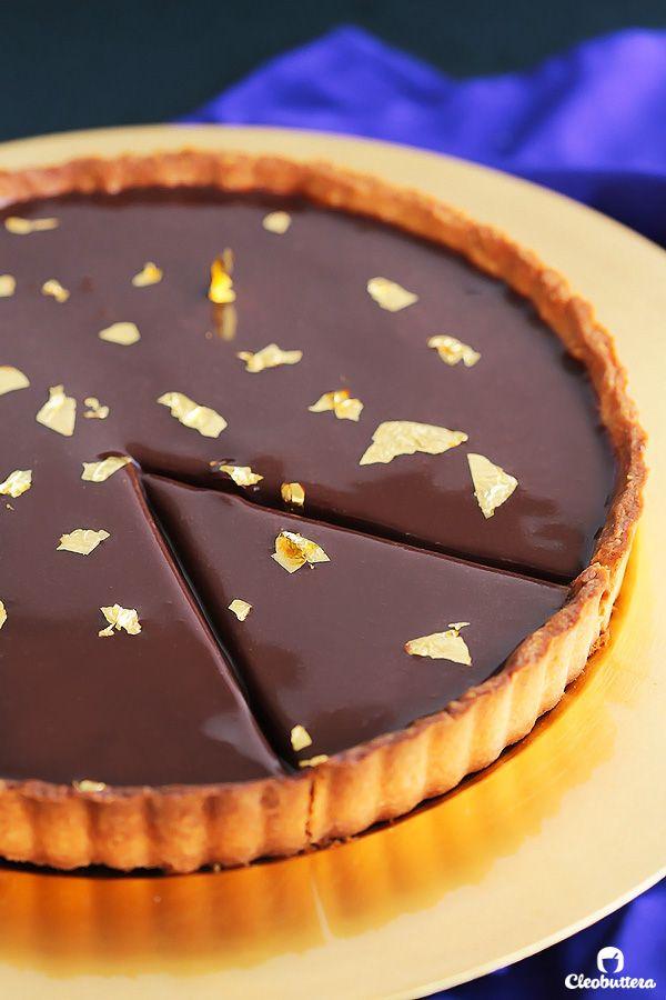 Luxurious Nutella Tart {Hazelnut tart shell, crunchy caramelized hazelnuts, silky Nutella ganache filling and a shiny Nutella glaze}.