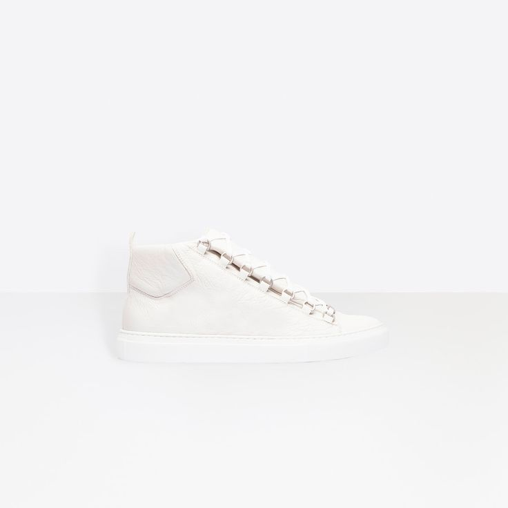 Discover the latest collection of Balenciaga Arena Sneakers for Men at the official online store.