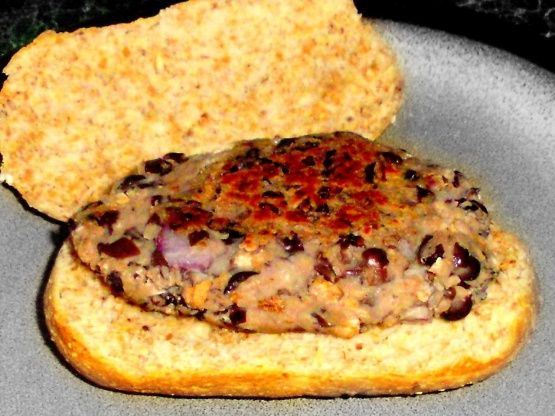 This is the first veggie burger I have ever tried and I was very impressed. I am not vegetarian, But I really enjoyed these! I dont know how these compare up to other black bean burgers, but I know these are super cheap, healthy, and very yummy! I found this recipe somewhere on Google and changed it to my tastes. I dont think they will hold up enough to be just thrown on the BBQ because these are soft burgers, but if you refrigerate your leftovers they are nice and firm and work in the oven…
