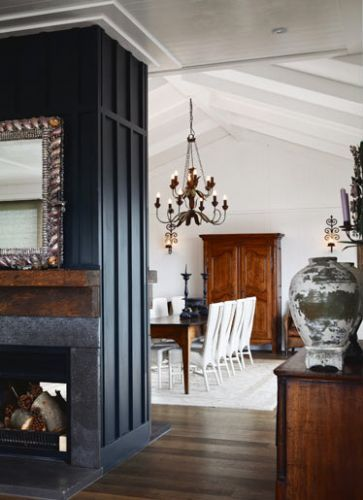 dark fireplace dividing room - Waiheke Island NZ home of designer Anna  Desbonnets