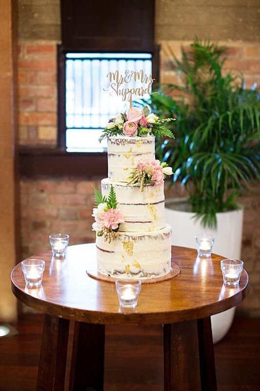 Eagle Farm Racecourse - Wedding Cake | Captured by Milque | G&M Event Group #WeddingDJ #BrisbaneWedding #BrisbaneRacingClub #FunWedding #tealights #wedding #reception #NakedWeddingCake #WeddingCake