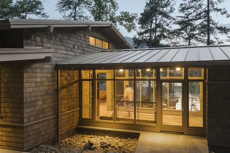 This vacation home�s glass-enclosed breezeway entrance allows for breathtaking lake views and connects the living and sleeping areas of the house.