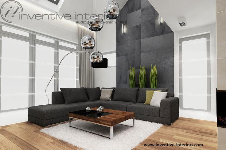 Projekt salonu Inventive Interiors - grafitowy narożnik w wysokim salonie z szarym kamieniem na ścianie