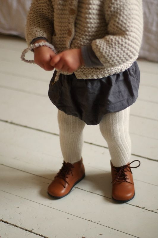 The ribbed stockings, bubble skirt little knitted cardi...so sweet!
