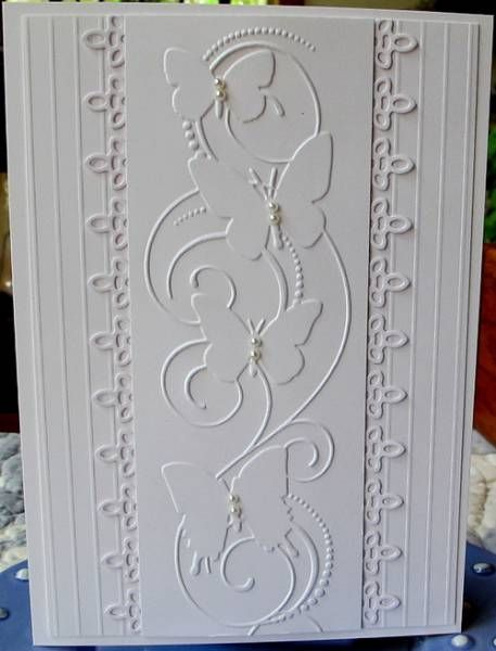 hand crafted card: White on White Butterflies ..central column ... layered panels ... like the layout with the border punching done on layer below the top ...
