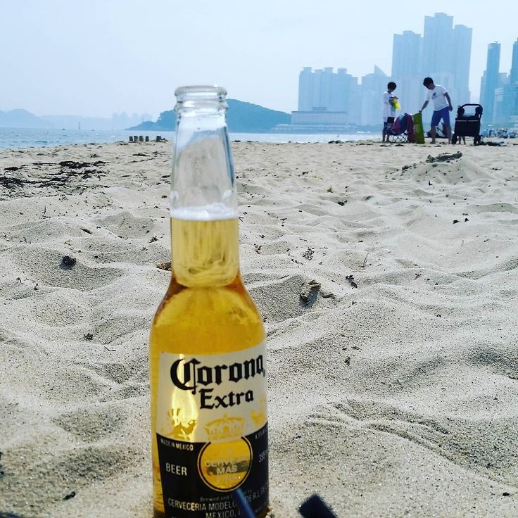 Lazy Saturday on #haeundaebeach  Laying on the #sand in the #sun watching the #surf Love the #beaches of #Busan (Better with #beer of course! #corona)