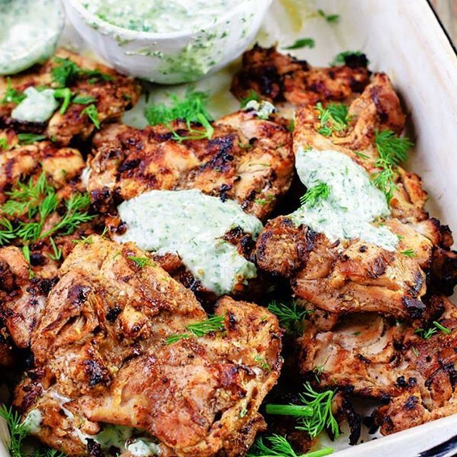 MEDITERRANEAN GRILLED CHICKEN + DILL GREEK YOGURT SAUCE Made by ❤️❤️ @themediterraneandish Serves: 8 INGREDIENTS For the Dill Greek Yogurt Sauce: 1 garlic clove, minced 1 cup chopped fresh dill, stems removed 1¼ cup Greek yogurt 1 tbsp olive oil Juice of ½ lemon or lime Pinch cayenne pepper, optional Salt, if needed For the Grilled Chicken: 10 garlic cloves, minced ½ tsp paprika ½ tsp allspice ½ tsp ground nutmeg ¼ tsp ground green cardamom Salt and pepper 5 tbsp olive oil, divided 8…