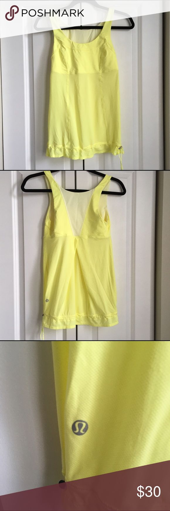 """Lululemon Elevate Tank - Yellow - Size 4 Women's Lululemon Yellow Elevate Tank!  Great for any sport or workout! Size 4 Built in bra. Mesh with drawstring bottom. Vented at the back  Lightweight. In excellent used condition. From a smoke free home. Measures 13"""" across and 26.5 in length from the top of the shoulder. lululemon athletica Tops Tank Tops"""