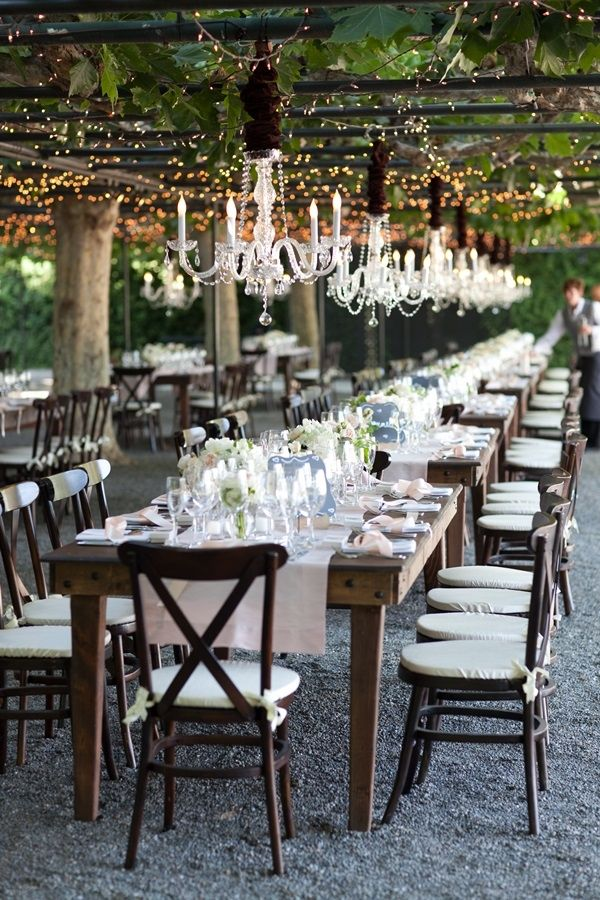 Elegant Wedding Table Under Chandelier | photography by http://www.juliemikos.com/