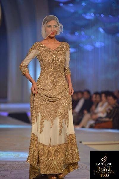 Beautiful gold detail and embellishment on a white Pakistani wedding dress by HSY Bridal 2014.