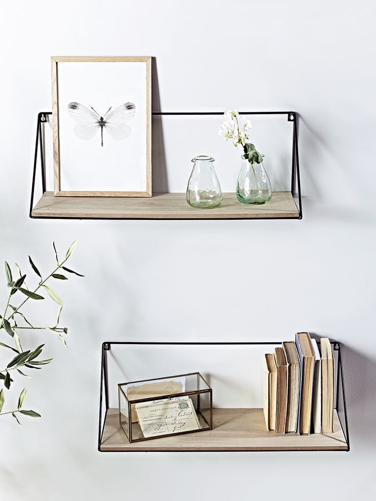 Crafted from rustic pine wood with a black iron frame, our pair of large shelves add a cool industrial look to your home. Also available in Small here, these contemporary shelves are easy to hang from the wall using the two keyhole hooks and are perfect for displaying anything from books and DVDs to keepsakes and decorative objet.