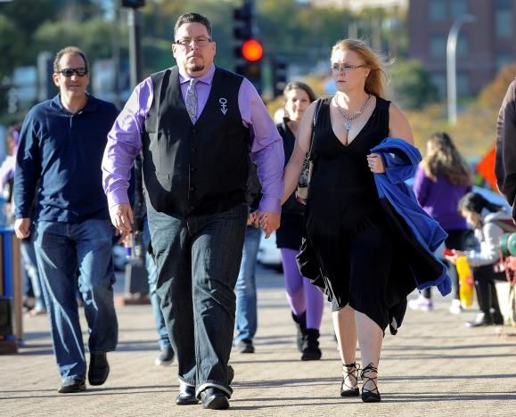 Eric Rogers, Winchester KY and his wife Bridget Rogers walk to Xcel Center as fans gather for an all-star concert paying tribute to Prince in St. Paul, Minnesota, U.S., October 13, 2016. REUTERS/Craig Lassig