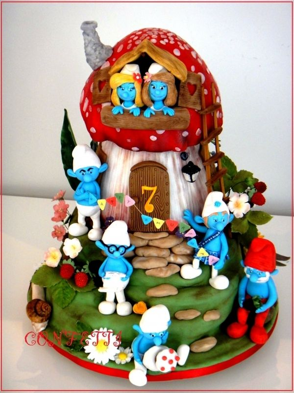 Okay, I absolutely HAVE to try and recreate this cake! I loved the smurfs as a kid and this cake is a work of art. It must have taken ages but this is definitely going in the 'recreate this' file.... ;o)