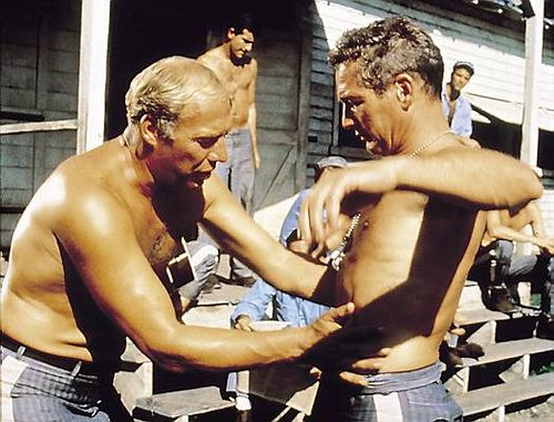 George Kennedy & Paul Newman in Cool Hand Luke. Hah! A funny scene leading up to the egg eating contest.