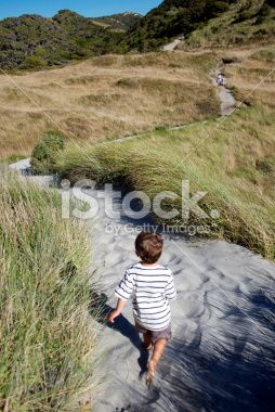 Child on a sandy footpath through sand dunes Royalty Free Stock Photo