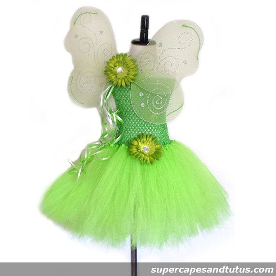 Tinkerbell Inspired Tutu Dress with Wings This beautiful Tinkerbell Inspired Tutu Dress is made with lime green tulle, lime green tutu top with a flower and rhinestone in the middle. Set of lime green