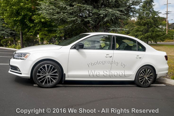 Left side view of a white 2016 VW Jetta Sport.  Seattle Automotive Photography by http://weshoot.com .