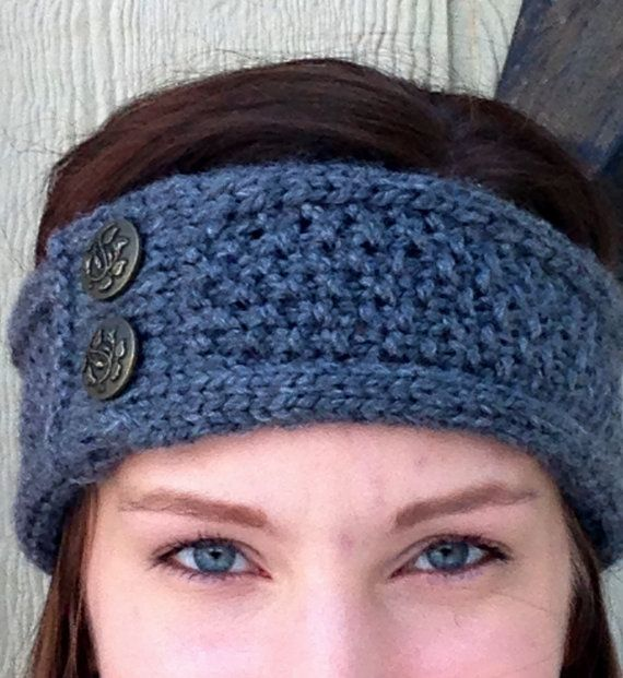 A super cozy earband to keep you warm all winter long. Made with super soft yarn and accented with two gorgeous decorative buttons. Measures approximately 19 around and stretches to fit a variety of head sizes. Please specify your choice of colour and buttons when ordering.  Washer/dryer safe.