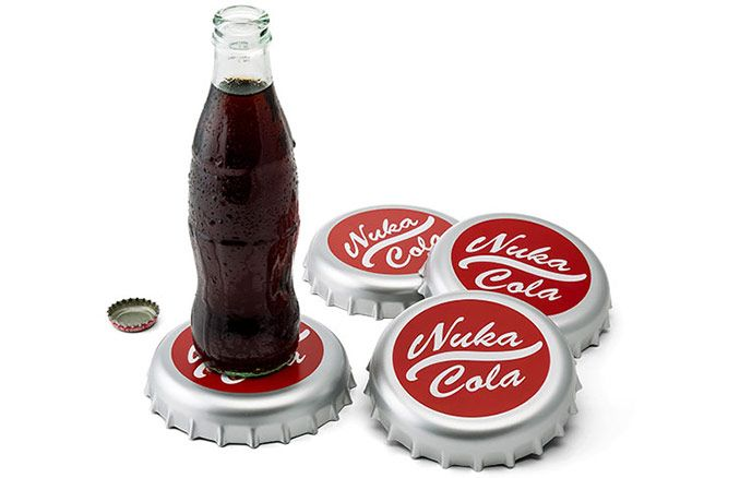 "Even in a post-apocalyptic future, you wouldn't want to leave rings on your nice tables. The perfect solution is Fallout Nuka Cola Bottle Cap Coasters. They look just like the Nuka-Cola bottle caps from Fallout, except these babies are about 4"" in diameter, making them the perfect size to use as bev"